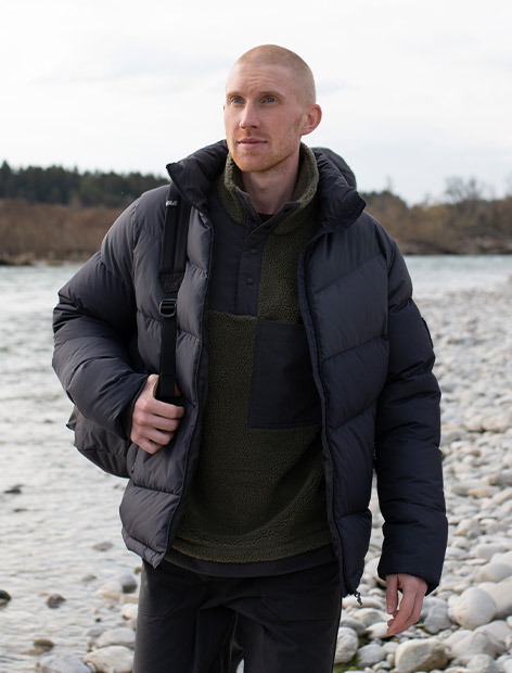 Man wearing a down jacket out in the countryside